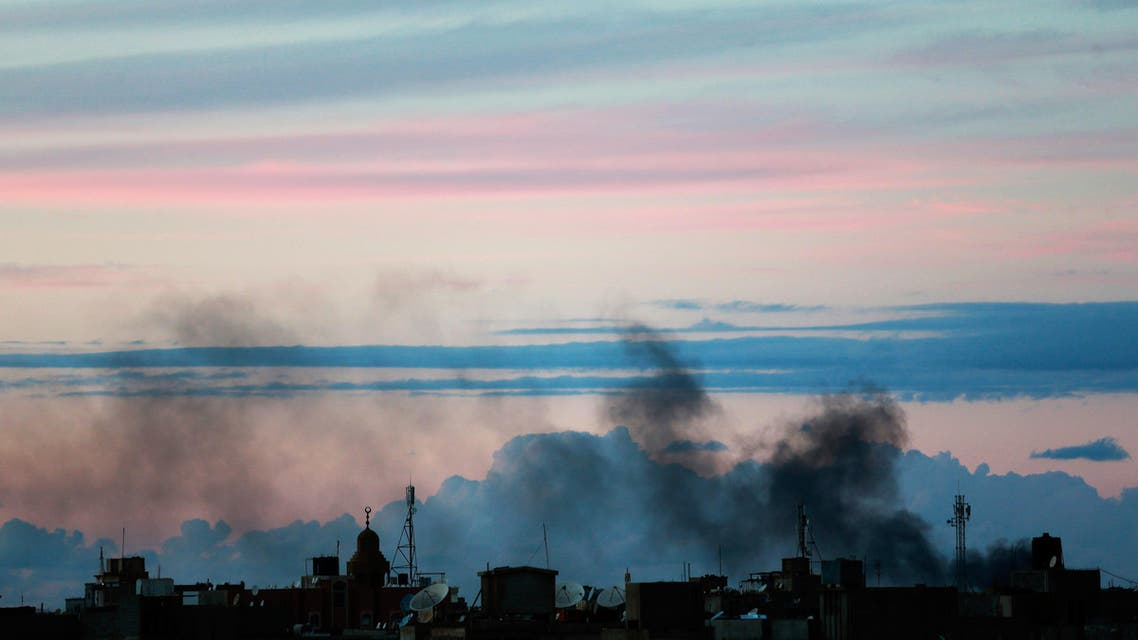 Black smoke billows in the sky above areas where clashes are taking place between pro-government forces, in Benghazi October 31, 2014. (Reuters)