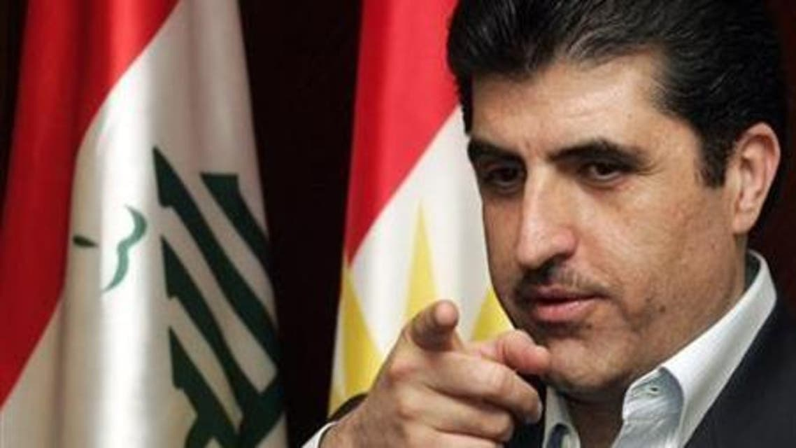 Iraqi Kurdistan Prime Minister Nechirvan Barzani gestures towards reporters during a news conference in Arbil, 310 km (190 miles) north of Baghdad March 24, 2009.  Reuters