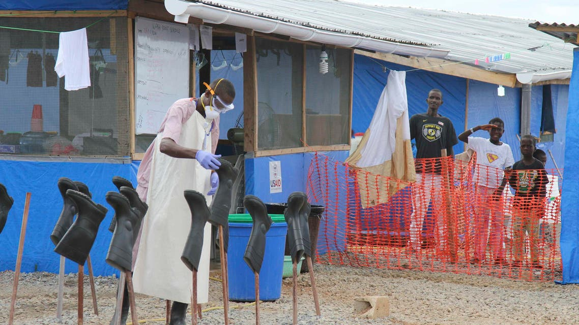 Boys Solomon (C, rear) and Joe (R, rear) stand in a zone where they are being treated for Ebola at a center about 200 km east of the capital, Monrovia, in this October 28, 2014 file photo. (Reuters)