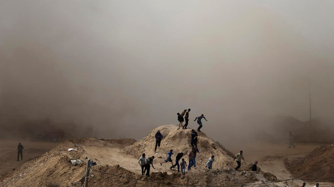 Palestinians run as smoke rises after a house is blown up during a military operation by Egyptian security forces in the Egyptian city of Rafah, on the border of the southern Gaza Strip with Egypt October 30, 2014. (Reuters)