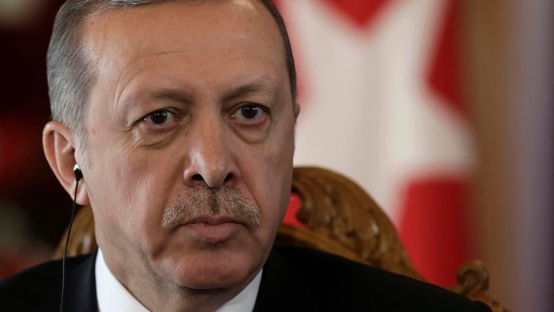 Turkey's President Recep Tayyip Erdogan listens during a news conference in Riga October 23, 2014. (Reuters)