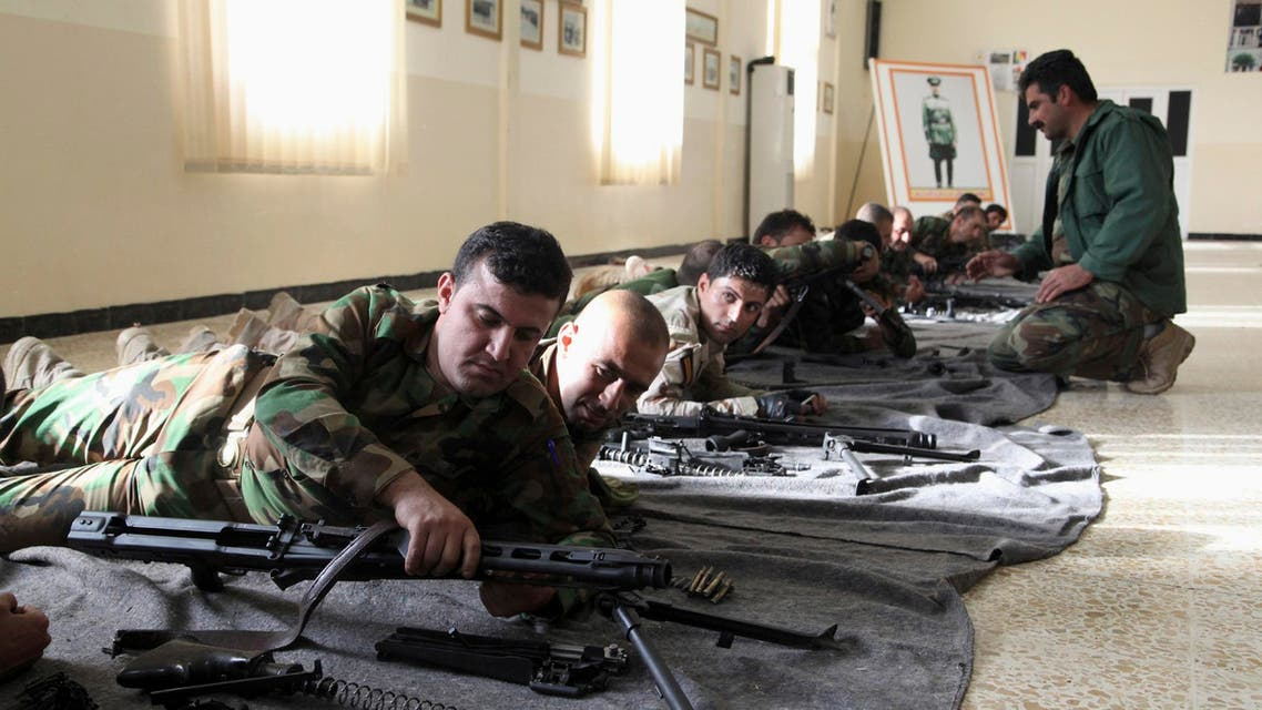 Kurdish peshmerga fighters take part in weapons training in the grounds of their camp in Erbil, November 3, 2014.  (Reuters)