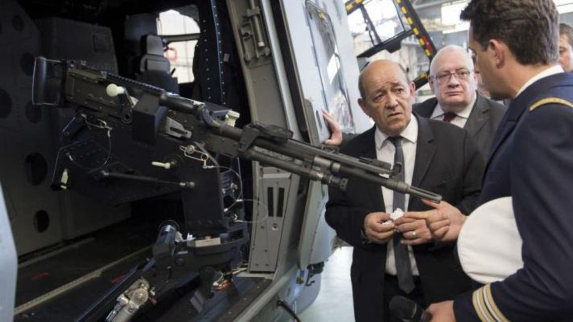 French Defence Minister Jean-Yves Le Drian inspects a weapons procurement agency last June AFP