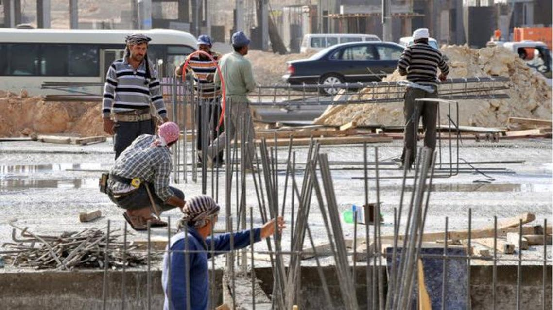 Foreign laborers work at a construction site in the Saudi capital Riyadh. AFP