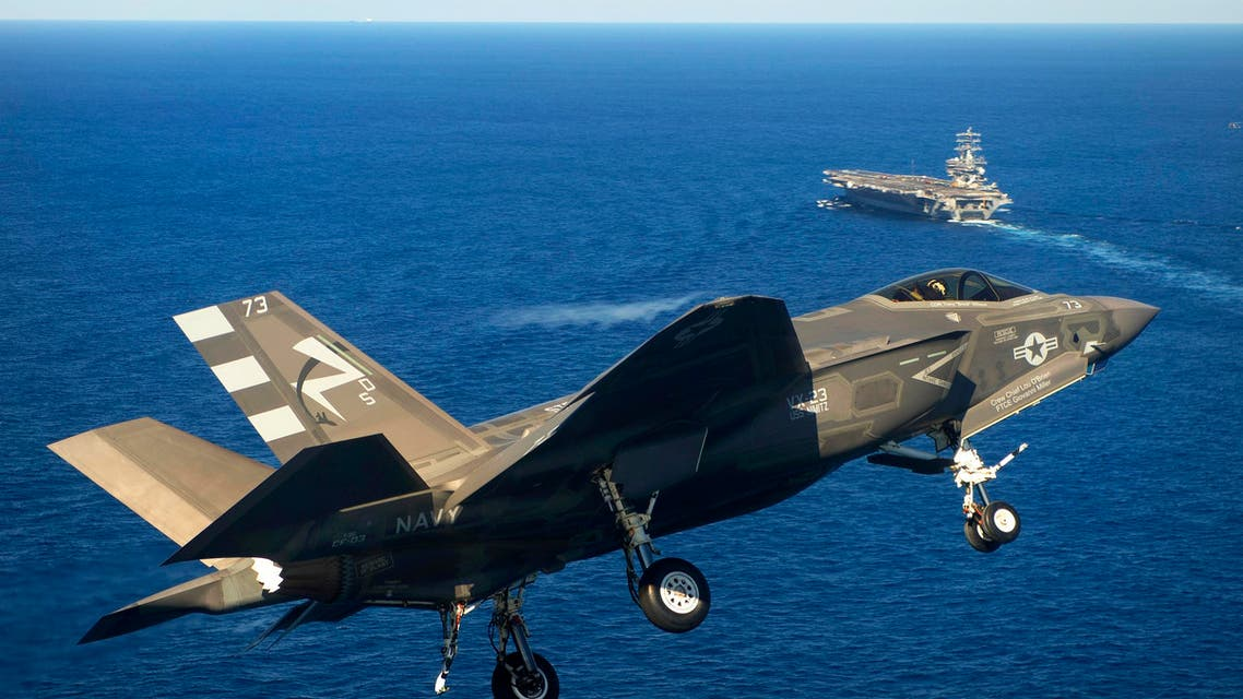 An F-35C Lightning II carrier variant joint strike fighter approaches the USS Nimitz to conduct an arrested landing in the Pacific Ocean, Nov. 3, 2014.  (U.S. Navy photo courtesy of Lockheed Martin by Andy Wolfe)