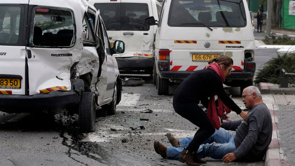 A wounded man sits on the street after an attack by a Palestinian motorist in Jerusalem November 5, 2014. (Reuters)