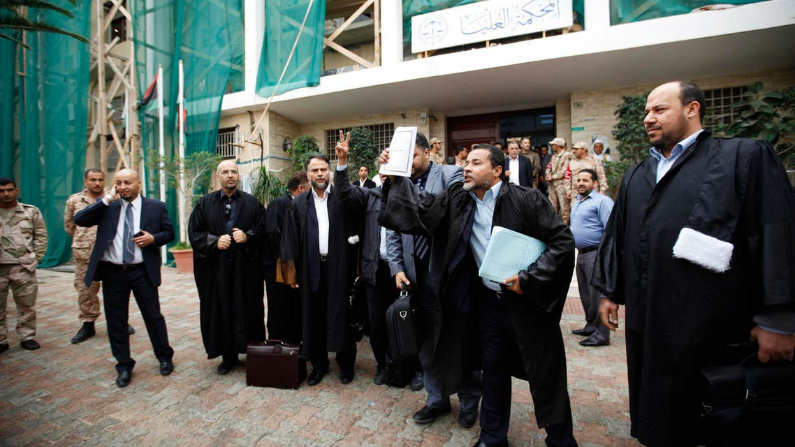 Libyan lawyers celebrate after the court invalidated the country's parliament, outside the Supreme Court in Tripoli, Nov. 6, 2014. (Reuters)