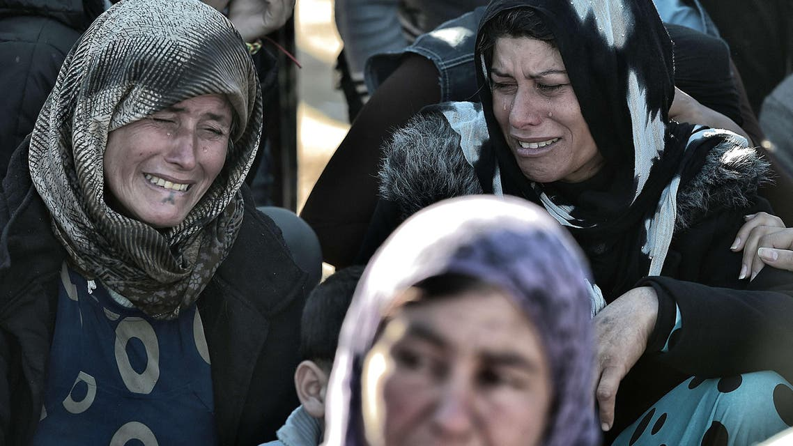 Women cry during the funeral of a Kurdish People's Protection Units (YPG) fighter in Suruc, Turkish southeastern Sanliurfa province, on November 6, 2014.