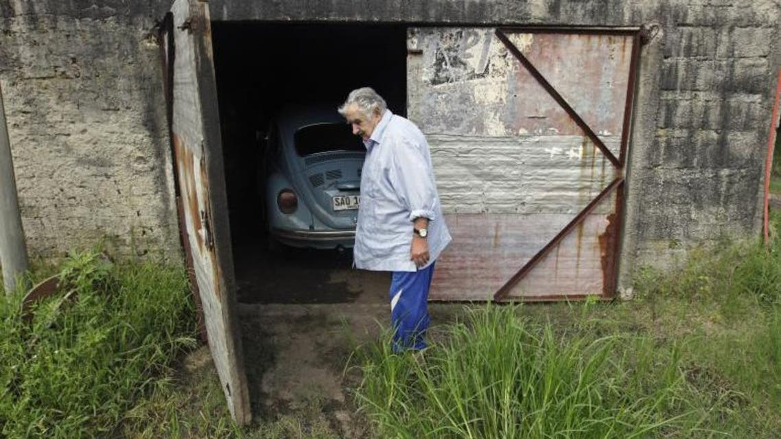 Uruguay's President José Mujica walks in front of his garage on his farm on the outskirts of Montevideo, Feb. 13, 2014.  Reuters