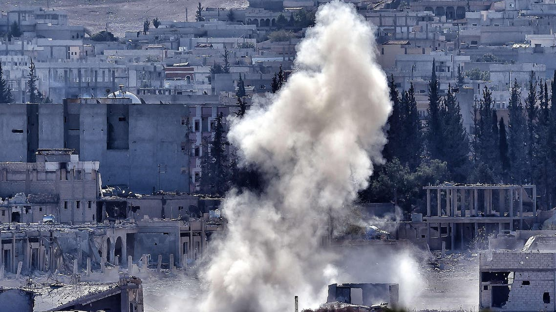 A picture taken on November 6, 2014 from the Turkish city of Mursitpinar shows smoke rising during a shelling by Islamic State militants to the Syrian city of Kobane,