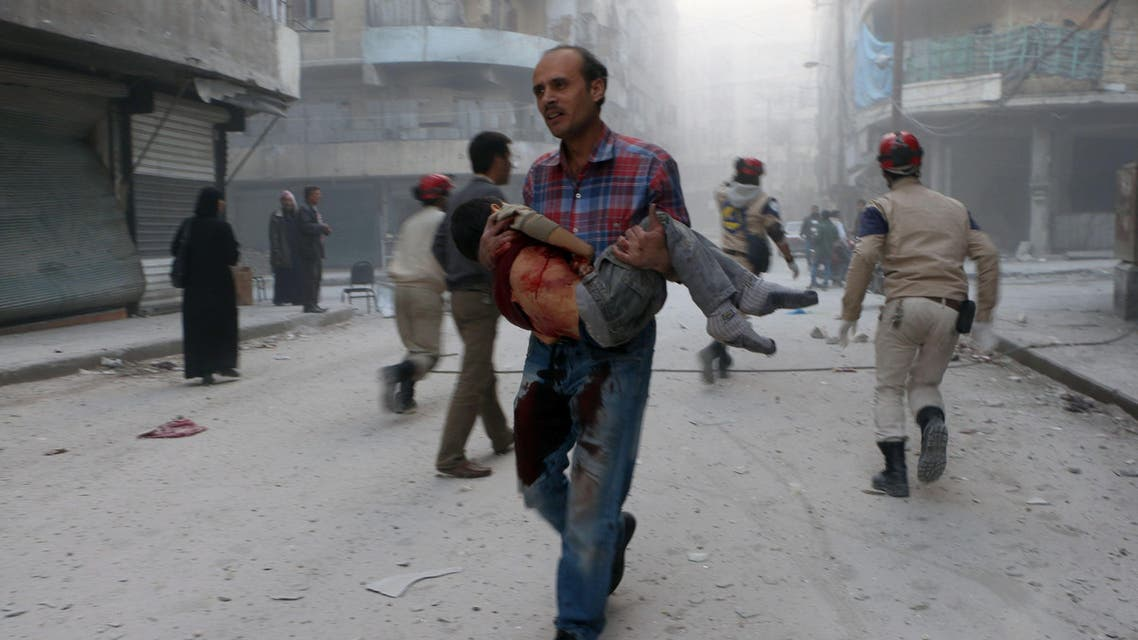 A man carries the body of his son following a reported barrel bomb attack by government forces AFP Syria