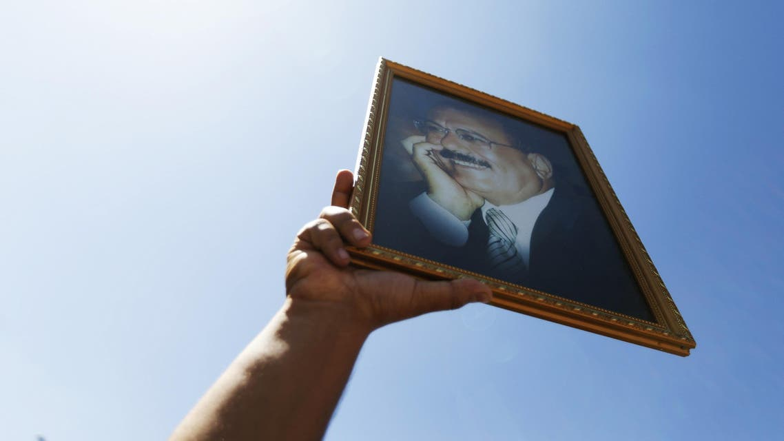 A supporter of Yemen's former President Ali Abdullah Saleh holds up a poster of Saleh during a rally in his support in Sanaa November 7, 2014. (Reuters)