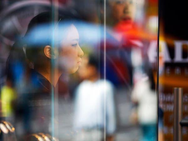 الصين تدفع تجارها إلى اقتحام عالم الماركات الفاخرة