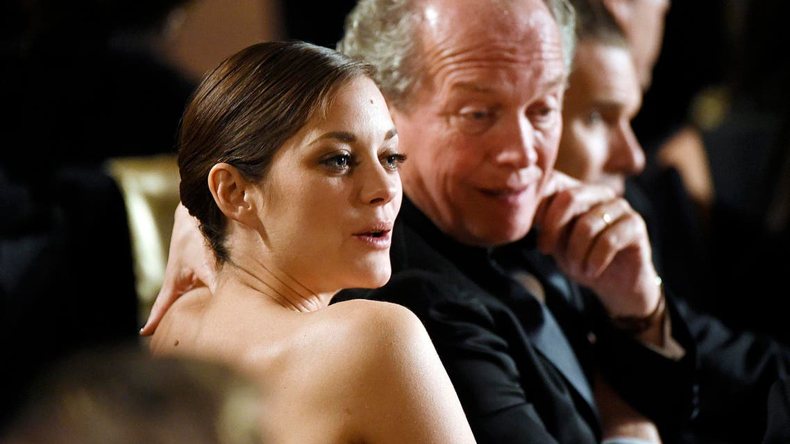 """Actress Marion Cotillard and director Luc Dardenne of the film """"Two Days, One Night"""" attend the Academy of Motion Picture Arts and Sciences Governors Awards in Los Angeles, California November 8, 2014. (Reuters)"""