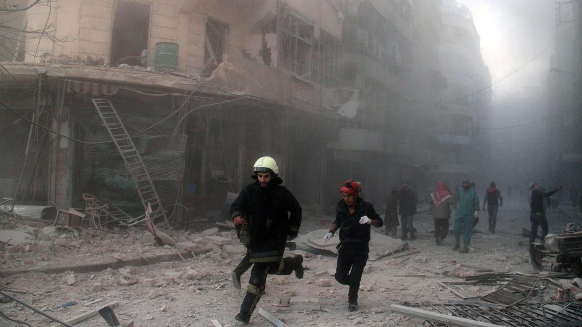 Emergency responders rush following a reported barrel bomb attack by government forces in the Al-Muasalat area in the northern Syrian city of Aleppo on November 6, 2014. (File photo: AFP)