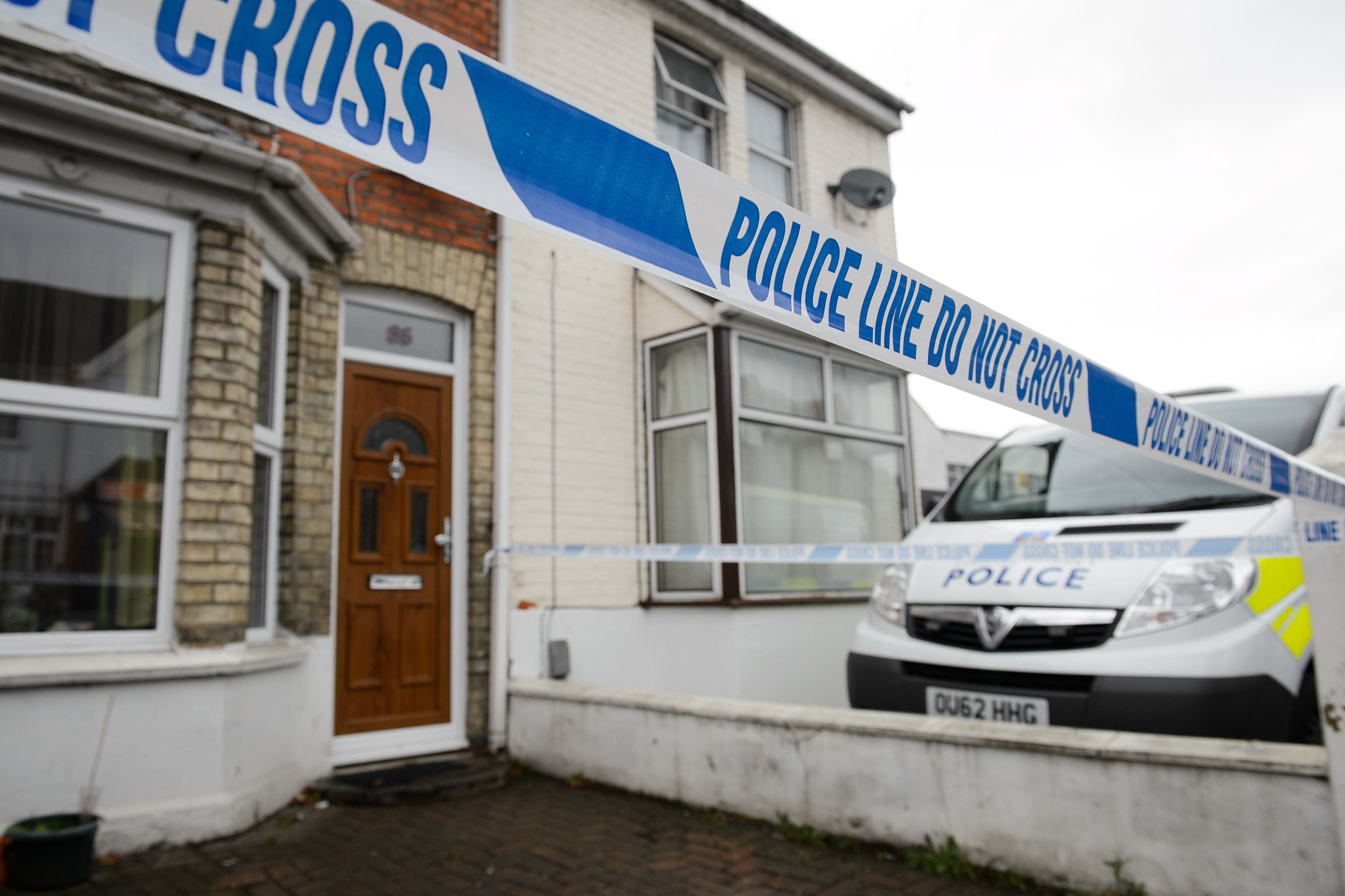 Police tape marks off the front of a residential address north west of London, on November 8, 2014. (AFP)