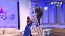 Watch this Romanian TV presenter's awkward post-fall attitude