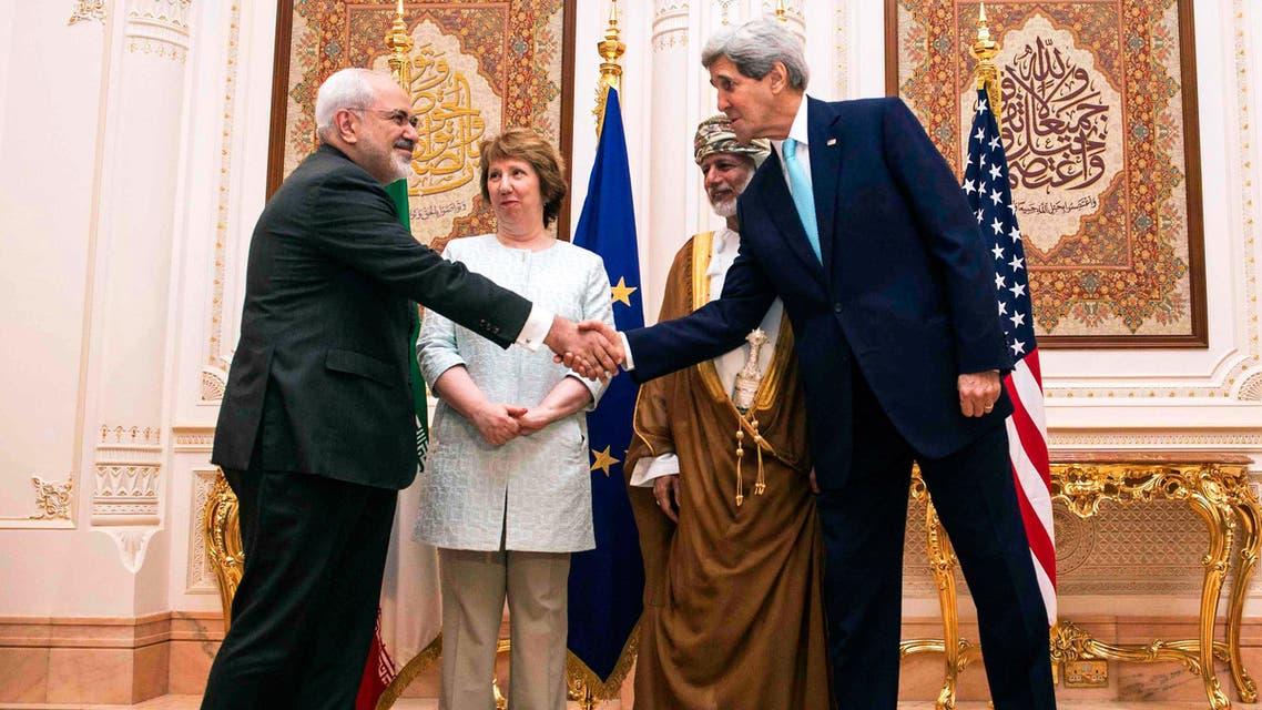 US Secretary of State John Kerry (R), former EU top diplomat Catherine Ashton (2ndU.S. Secretary of State John Kerry (R) and Iranian Foreign Minister Mohammad Javad Zarif (L) shake hands. (Reuters)