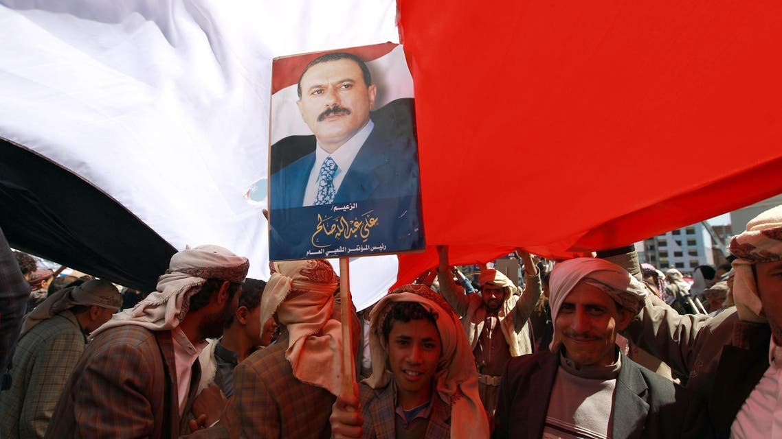 A young supporter of Yemen's former president Ali Abdullah Saleh holds a portrait of him during a rally on Nov. 7, 2014 in Tahrir Square in the capital Sanaa. (AFP)