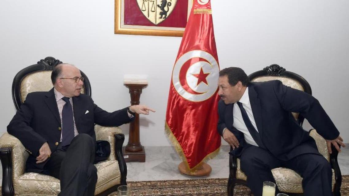TUNISIA-FRANCE-POLITICS-DIPLOMACY, MOY Tunisia's Minister of Interior, Lotfi Ben Jeddou (R) smiles with his French counterpart Bernard Cazeneuve (L) in Tunis on November 10, 2014.