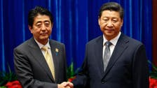 Watch China's Xi and Japan's Abe exchange awkward handshake