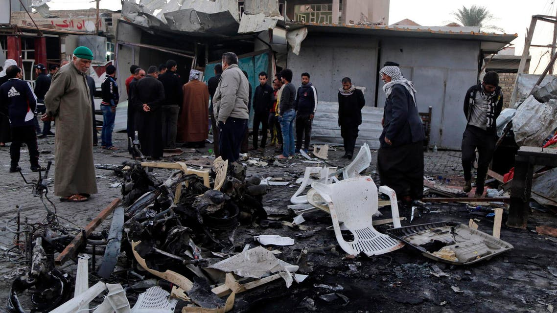 People gather at the site of a car bomb attack in Baghdad's Sadr City, November 9, 2014. (Reuters)