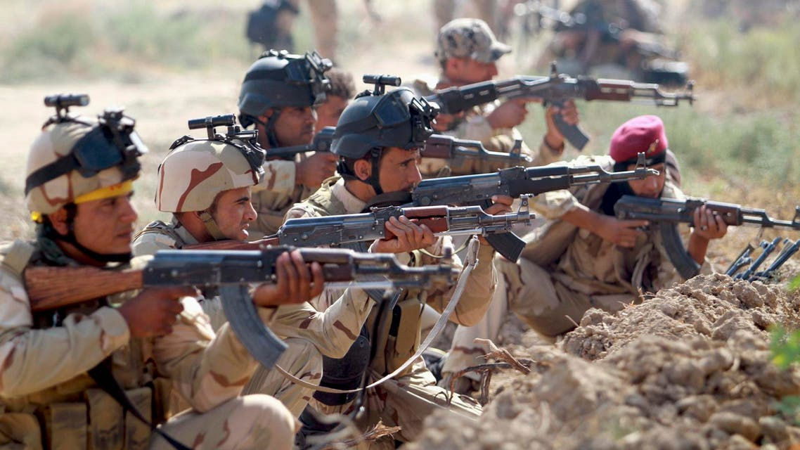 Iraqi Army personnel take part during an intensive security deployment against Islamic State militants in Jurf al-Sakhar October 27, 2014. Picture taken Oct. 27, 2014. (Reuters)