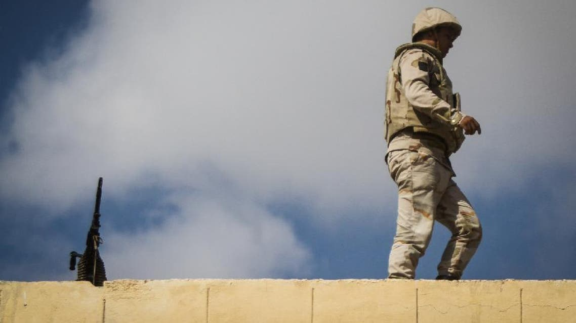 An Egyptian soldier stands guard along the Rafah border with Israel on July 19, 2014. AFP