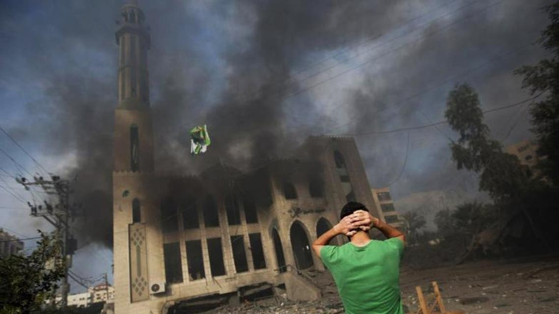 A Palestinian man reacts in front of a destroyed mosque after it was hit by an Israeli air strike, on July 29, 2014, in Gaza City. (AFP)