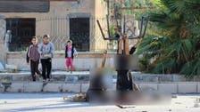 Shocking ISIS photo: children gaze at decapitated men