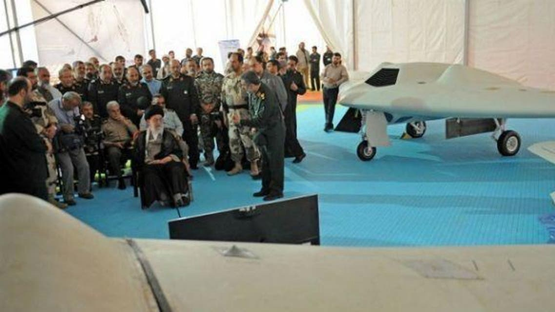Iran's Supreme Leader Ayatollah Ali Khamenei sitting next to a captured U.S. RQ-170 drone that crashed in Iran on December 2011, and its locally made copy. (File photo:AFP)