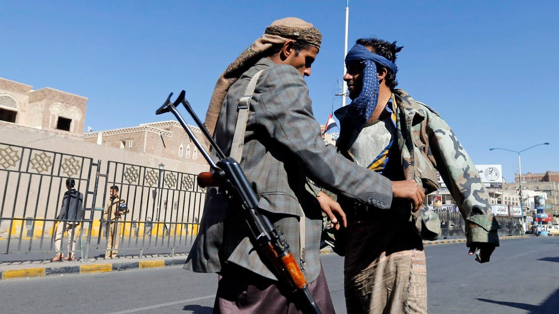 A Shi'ite Houthi rebel searches a man at a checkpoint in Sanaa November 4, 2014. An advance into Yemen's Sunni Muslim heartland by Shi'ite Houthi fighters has galvanised support for al Qaeda among some Sunnis, deepening the religious hue of the country's many conflicts, with potential consequences well beyond its borders.