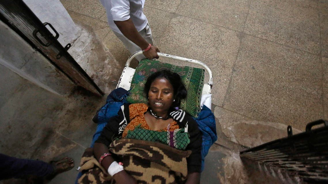 A woman, who underwent a sterilisation surgery at a government mass sterilisation camp, lies on a stretcher as she is taken to a hospital in Bilaspur, in the eastern Indian state of Chhattisgarh November 14, 2014. (Reuters)