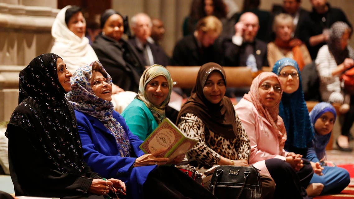 Women talk as the Washington National Cathedral and five Muslim groups hold the first celebration of Muslim Friday Prayers, Jumaa, in the Cathedral's North Transept in Washington, November 14, 2014. (Reuters)