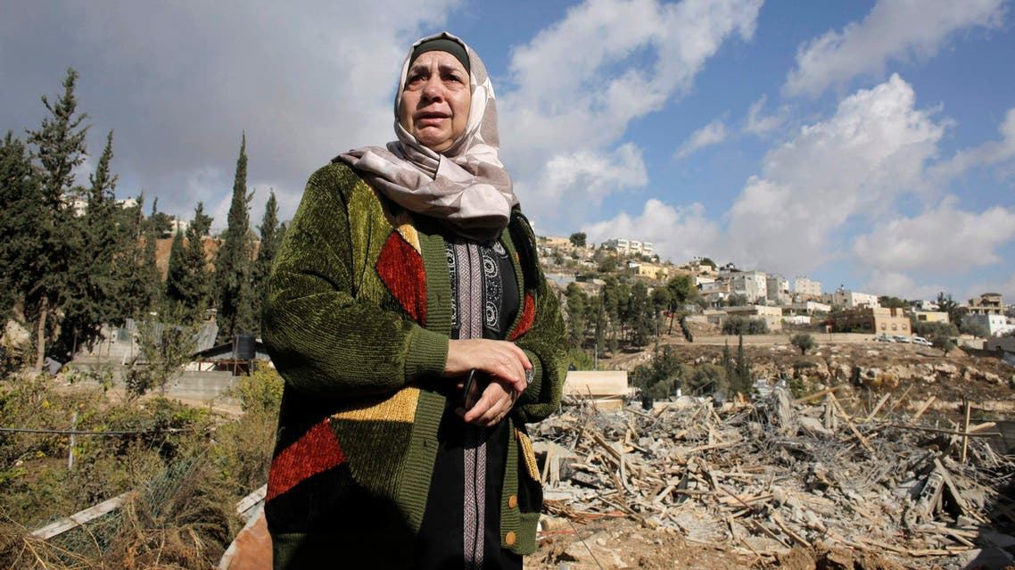 Palestinian Um Issam stands near the rubble of her demolished house in the East Jerusalem neighbourhood of Abu Tor November 4, 2014. (Reuters)