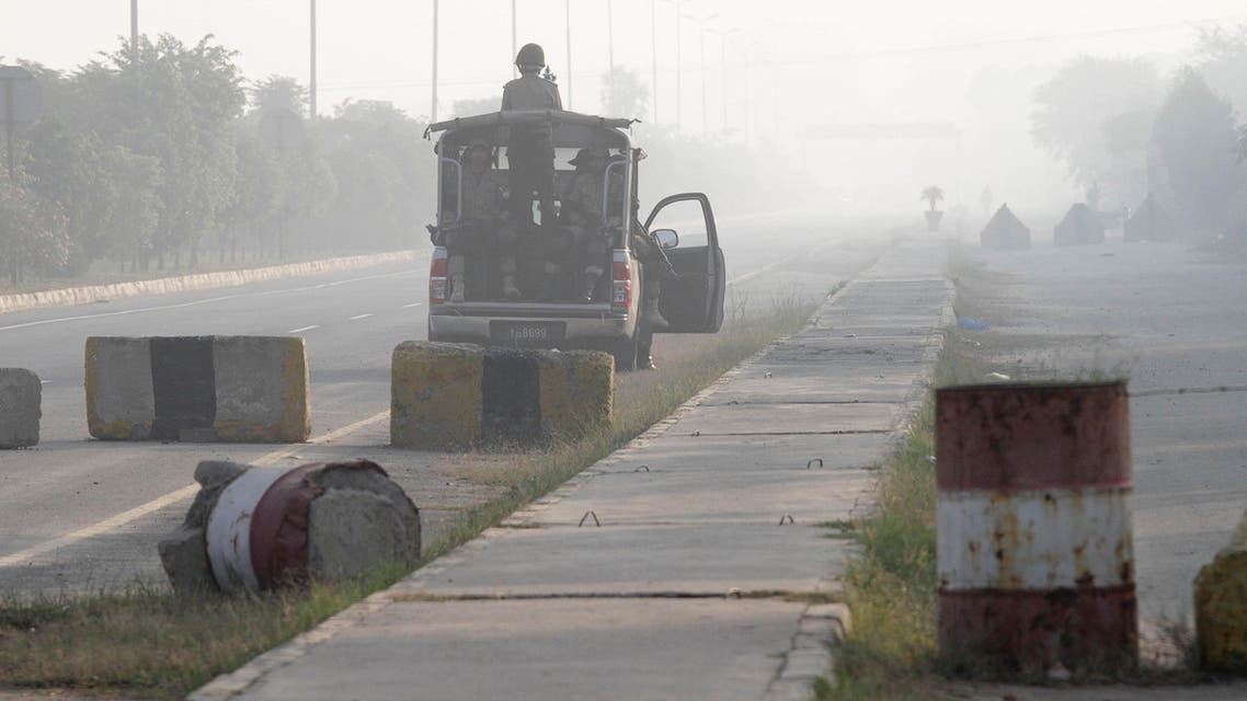 Soldiers from the Pakistan Rangers stand guard in a vehicle along a road leading to the Wagah border, near Lahore. (File photo: Reuters)