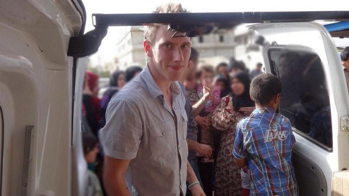 Peter Kassig in front of a truck somewhere along the Syrian border between late 2012 and autumn 2013 as Special Emergency Response and Assistance (SERA) was delivering supplies to refugees. (AFP)