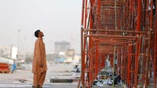 India urges higher pay for millions of Gulf workers