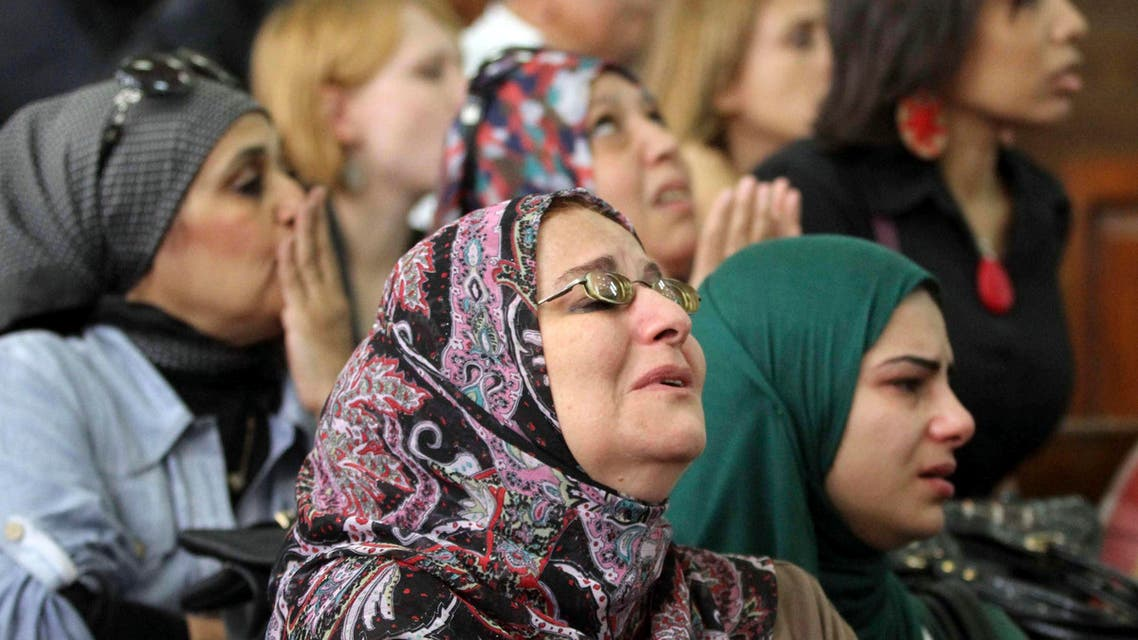 """Relatives of detained activists cry and pray for them as the activists stand trial at a court in Cairo, November 11, 2014. An Egyptian judge ordered 21 democracy activists - including leading campaigner Alaa Abdel Fattah - to be arrested on October 27 at the start of their retrial for breaking a law against protests passed after the military ousted former President, Mohamed Mursi last year. The activists - including leading campaigner Alaa Abdel Fattah - chanted """"down with military rule"""" and """"down with the military judiciary"""" from their courtroom cage after the judge read out his decision. REUTERS/Al Youm Al Saabi Newspaper (EGYPT - Tags: CIVIL UNREST CRIME LAW POLITICS) EGYPT OUT. NO COMMERCIAL OR EDITORIAL SALES IN EGYPT"""