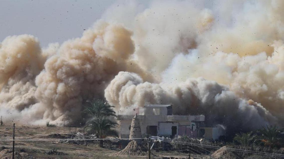 Smoke rises as a house is blown up during a military operation by Egyptian security forces in the Egyptian city of Rafah, near the border with southern Gaza Strip November 6, 2014. REUTERS/Ibraheem Abu Mustafa