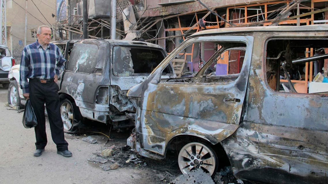 A man looks at the damage at the site of a car bomb attack in Baghdad November 15, 2014. (File photo: Reuters)
