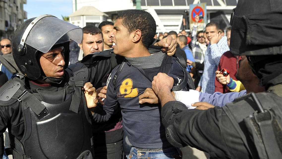 Egyptian police detain a supporter of the Muslim Brotherhood during clashes in Alexandria on January 23, 2014. AFP