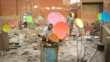 Coloring Cairo: Artists on quest to paint city's satellite dishes