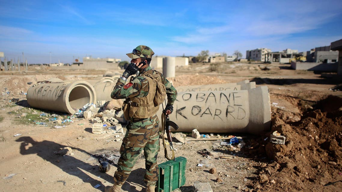 AD12 - Ain al-Arab, -, SYRIA : (FILES) - A file picture taken on November 8, 2014, shows a Kurdish Peshmerga fighter talking on the phone during fighting against Islamic State (IS) group in the Syrian besieged border town of Ain al-Arab (known as Kobane by the Kurds). US-led air strikes hit jihadist positions in the north and east of Syria, including an oil field, the Syrian Observatory for Human Rights said. AFP PHOTO / AHMED DEEB