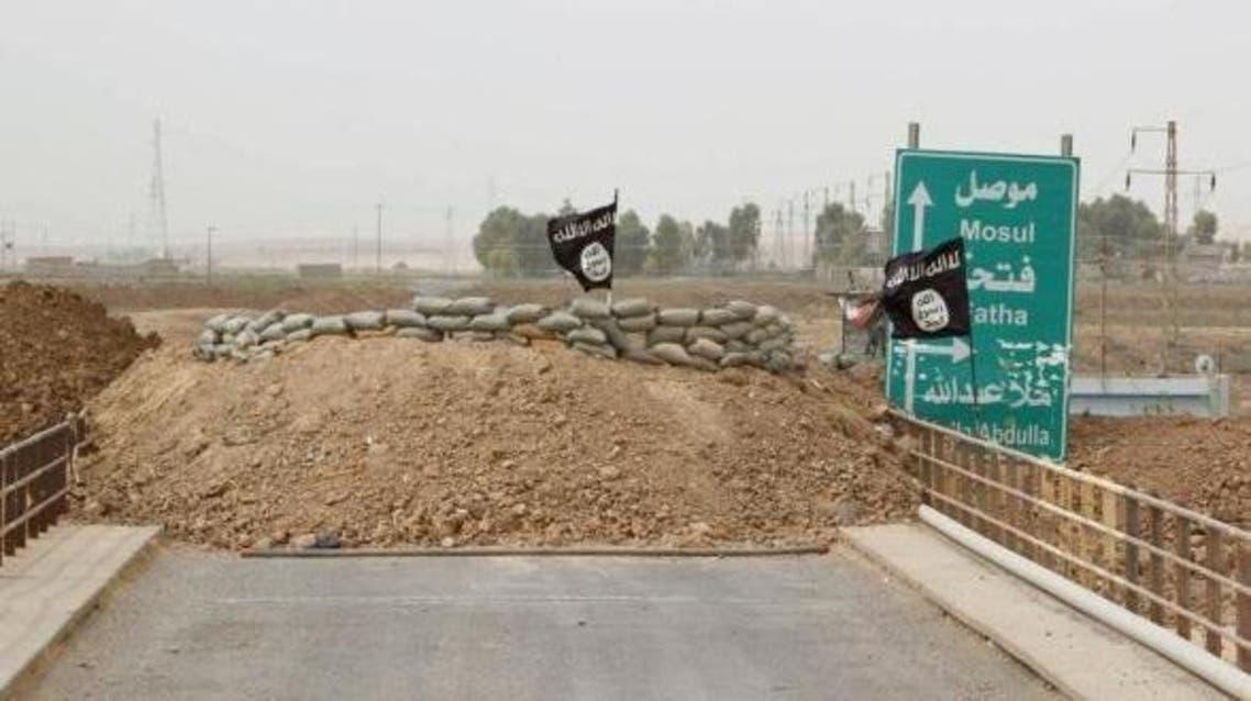 Islamic State flags flutter on the Mullah Abdullah bridge in southern Kirkuk September 29, 2014.
