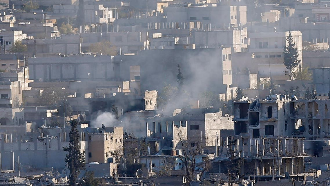 A view shows smoke raising from an eastern Kobani neighbourhood, damaged by fighting between Islamic State militants and Kurdish forces, November 18, 2014. Picture taken from the Turkish side of the Turkey-Syria border. REUTERS/Osman Orsal (SYRIA - Tags: CONFLICT CIVIL UNREST)