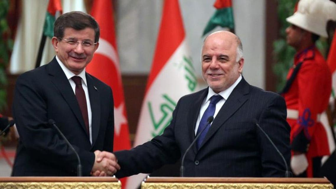 A handout picture made available by the Iraqi Prime Minister's Office on November 20, 2014 shows Iraq's Prime Minister Haidar al-Abadi (R) shaking hands with his Turkish counterpart Ahmet Davutoglu in Baghdad. AFP