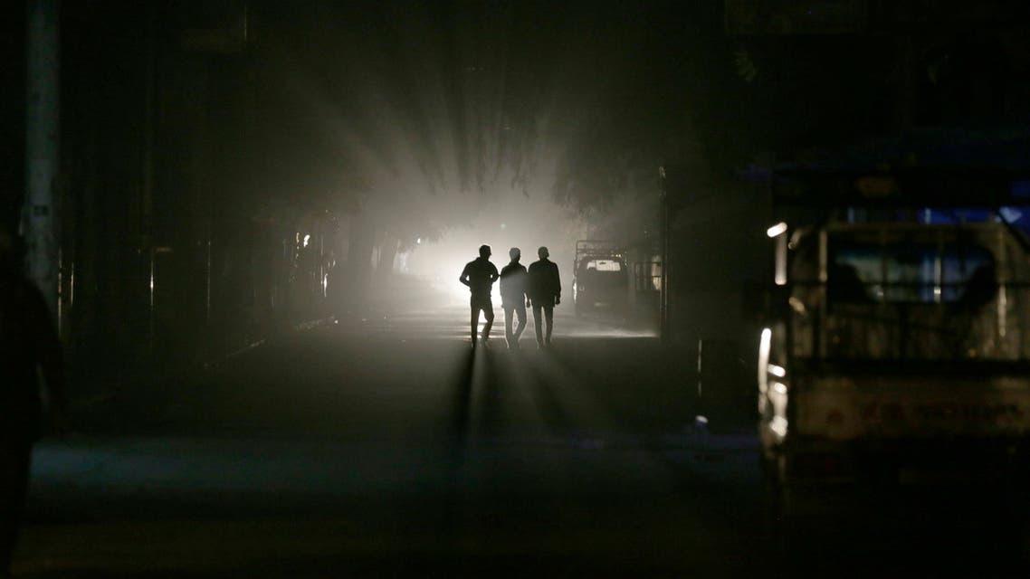 Men walk along a street at night in eastern al-Ghouta, near Damascus November 19, 2014. (Reuters)