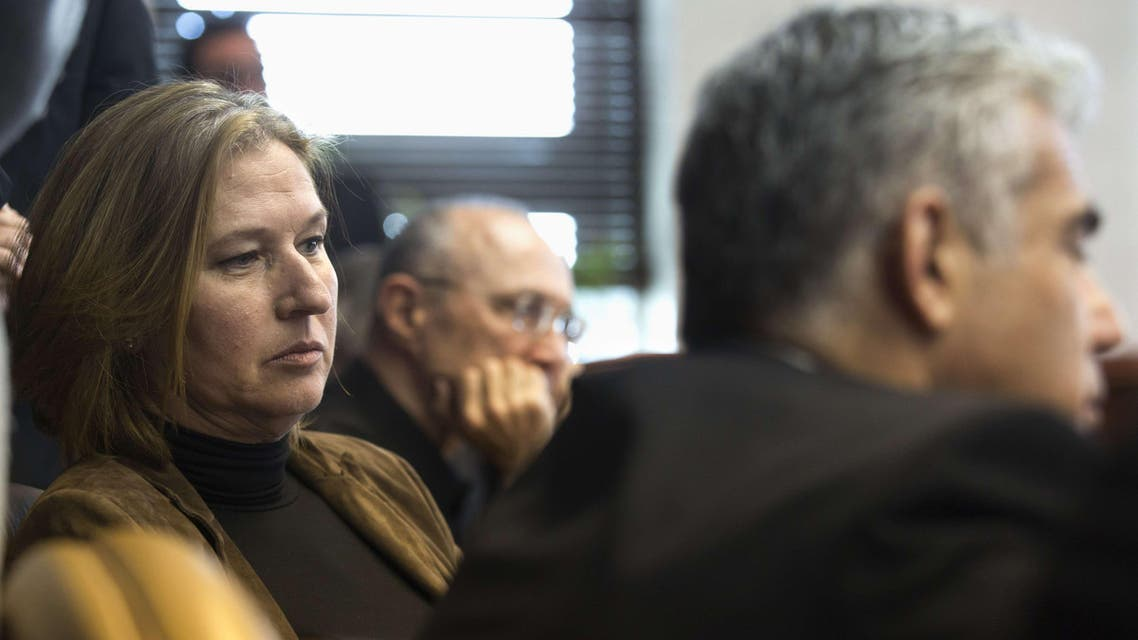Israeli Justice Minister Tzipi Livni (L) and Finance Minister Yair Lapid (R) listen to Prime Minister Benjamin Netanyahu (unseen) during the weekly cabinet meeting at the latter's office in Jerusalem on Nov. 23, 2014. (AFP)