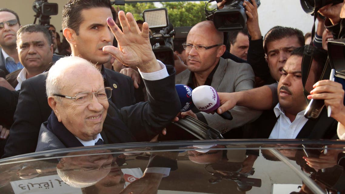 Beji Caid Essebsi (L), leader of Tunisia's secular Nidaa Tounes party and a presidential candidate, gestures after casting his vote at a polling station in Tunis Nov. 23, 2014. (AFP)